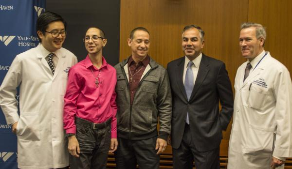 3-time kidney recipient Ryan DeSilva, 23, with his father and the medical team at Yale-New Haven Hospital.