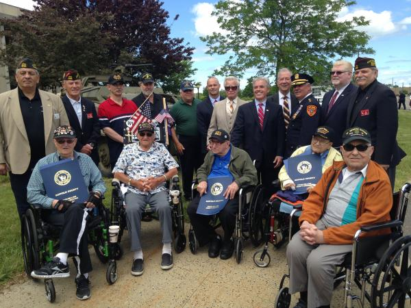 Suffolk County officials and veterans at the Suffolk County Police Department's headquarters in Yaphank. Baldassare Gebbia, wearing a green jacket, is pictured in the middle of the photo.