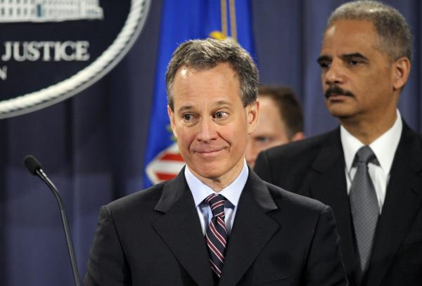 New York Attorney General Eric Schneiderman, accompanied by Attorney General Eric Holder, speaks at the Justice Department in Washington, Friday, Jan. 27, 2012, after Holder announced the formation of the Residential Mortgage-Backed Securities Working Group.