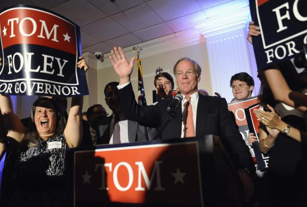 Republican gubernatorial candidate Tom Foley, center, speaks to supporters as his wife Leslie, right, looks on after defeating John McKinney in the Republican primary for Connecticut governor, Tuesday, Aug. 12, 2014, in Waterbury, Conn.