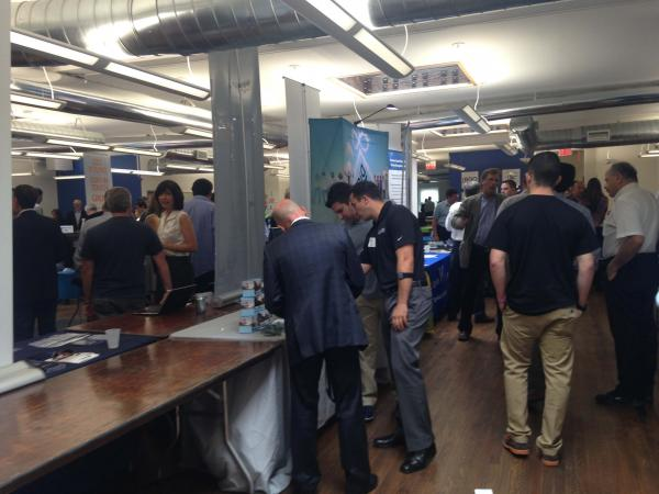 Companies set up tables to display their products to potential investors and employees at Launchpad LI's Tech Day in Huntington. Launchpad LI is an incubator, business accelerator, and coworking community space on Long Island.
