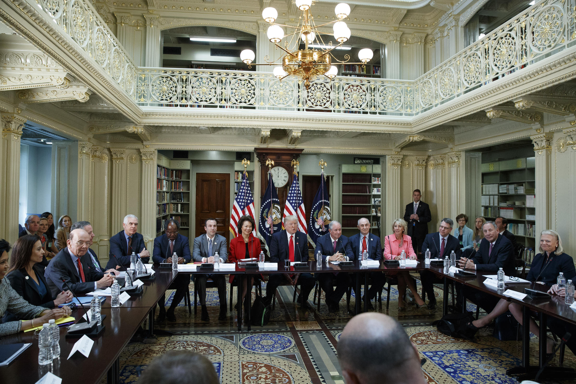 President Donald Trump speaks during a meeting with business leaders in the State Department Library of the Eisenhower Executive Office Building on the White House complex in Washington Tuesday