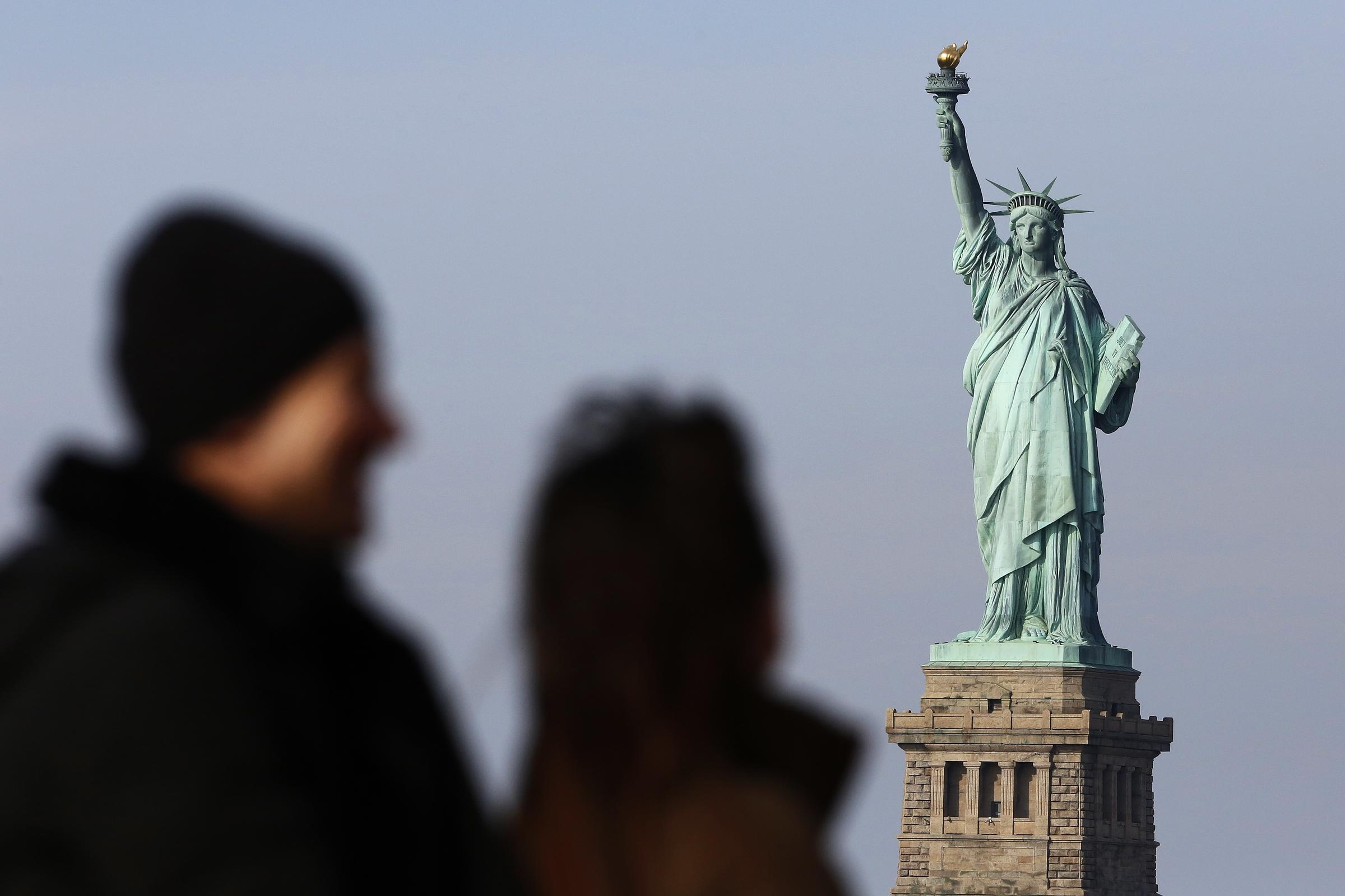 The Newest: Governor vows to reopen Statue of Liberty