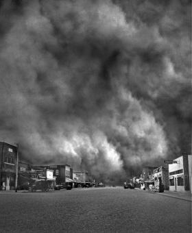 The huge Black Sunday storm - the worst storm of the decade-long Dust Bowl in the southern Plains - as it approaches Ulysses, Kansas, April 14, 1935. Daylight turned to total blackness in mid-afternoon.