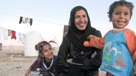 Rafea, shown with two of her four children, travels outside her Jordanian village for the first time to attend the solar engineering program at India's Barefoot College. Her story is profiled in the Independent Lens film Solar Mamas.