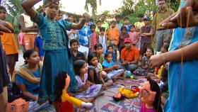Lawyer Amlan Ganguly and a group of children put on a puppet show about the need for clean water in a Kolkata neighborhood.