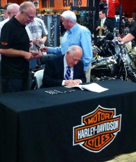 IL Gov. Pat Quinn signs law in Marion on Tuesday changing how Poker Runs are licensed in the state.