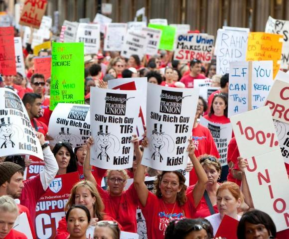 Striking Chicago teachers and supporters rally in the city during day 2 of the walkout.