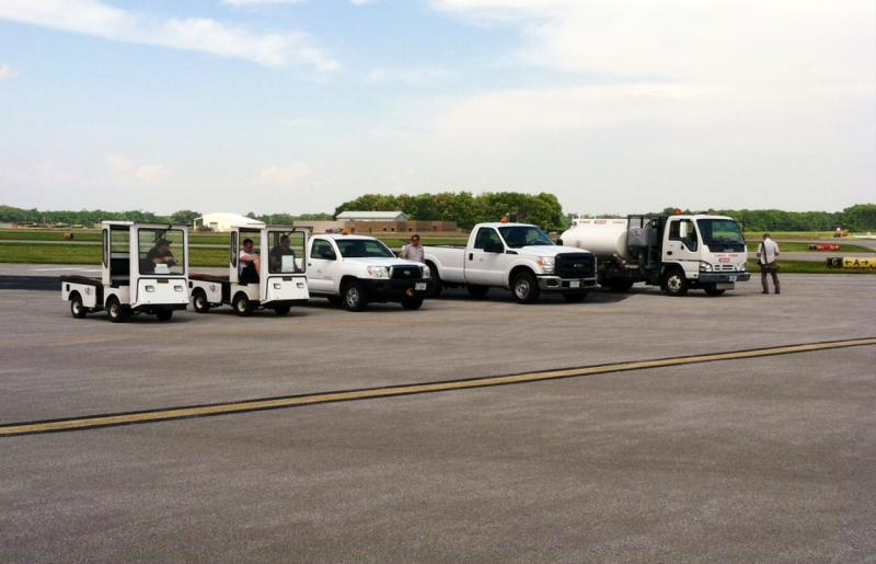 SIU Aviation and airport vehicles line up on tarmac.