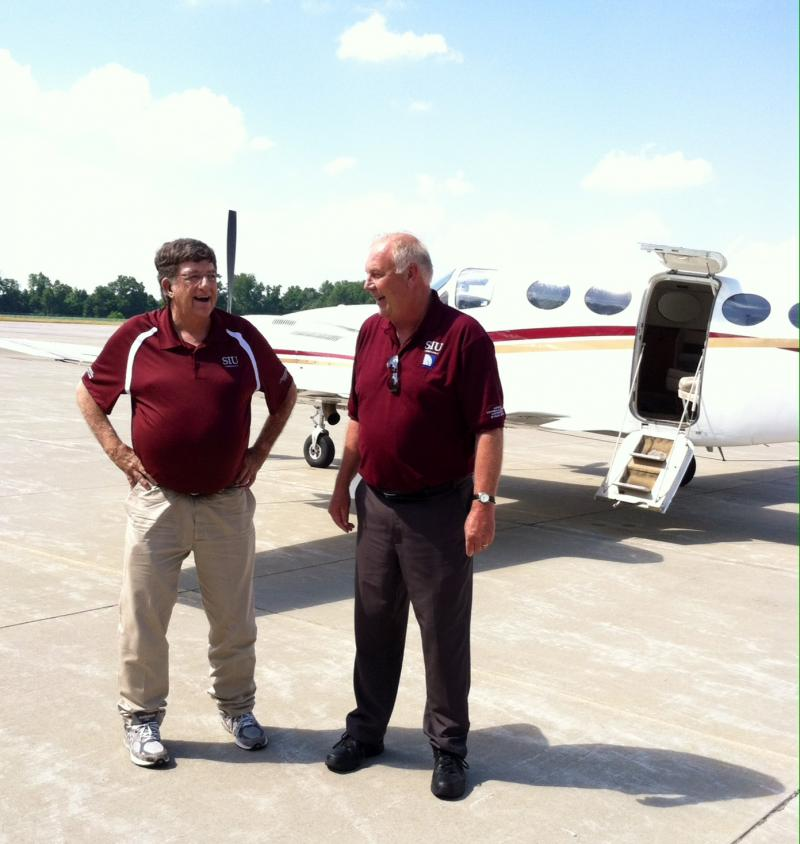 SIU Aviation Chiar David NewMyer (l) and Chief Transport pilot Keith Mortag (r) return from a training flight.  Both are retiring at the end of June.