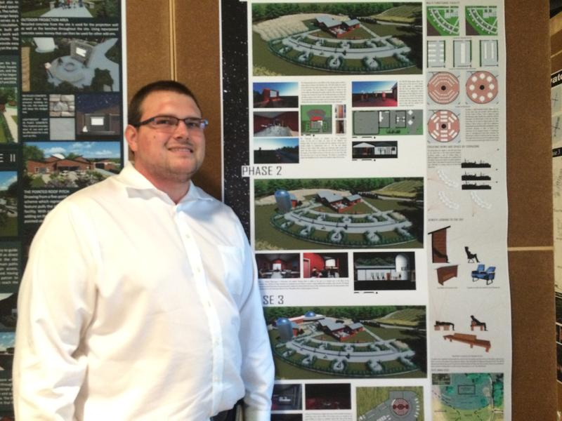 Architecture Student Aaron Oohie beside his design