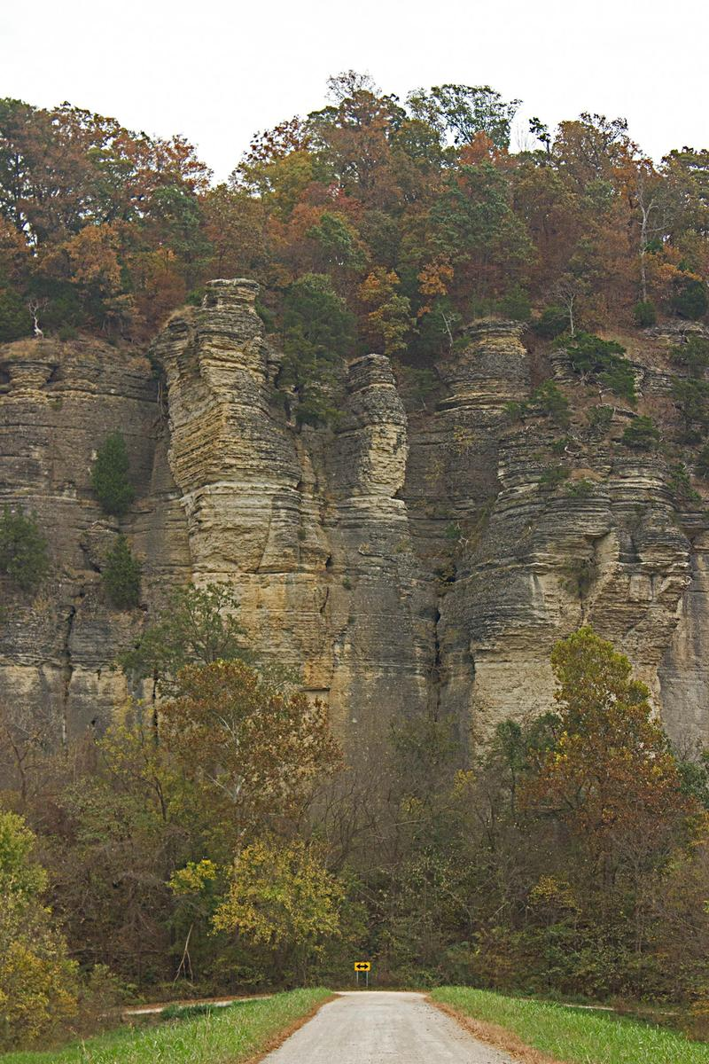 A Line of 200 foot tall Limestone Cliffs Line Snake Road.