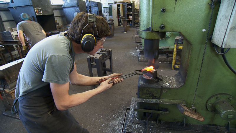 Student Using a Power Forging Hammer