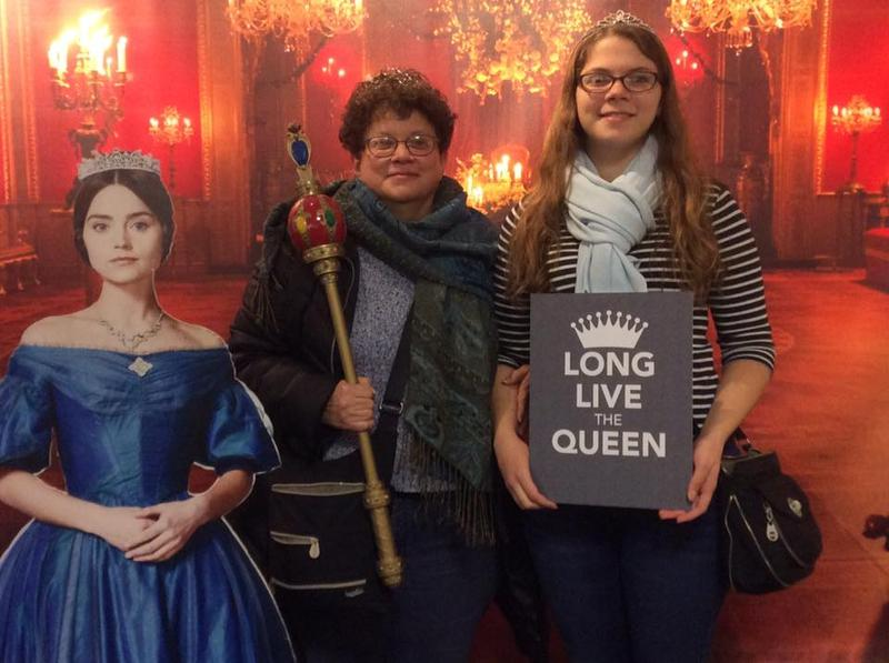 Amy Weber and Esther Hughes pose at the 'Royal Selfie Station' at the Victoria screening held on Thu, Jan. 4 2018 at the Varsity Center in Carbondale, Ill.