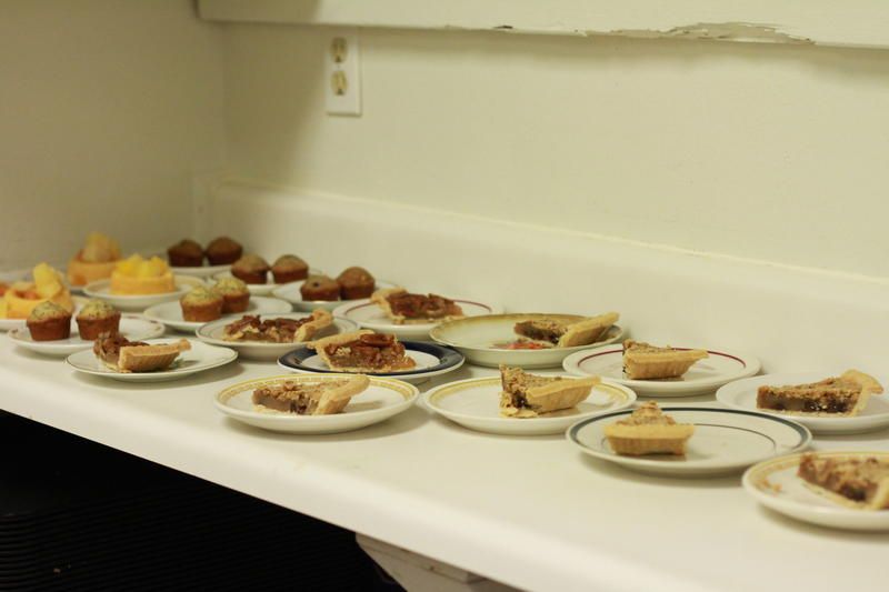 A counter full of various dessert items.