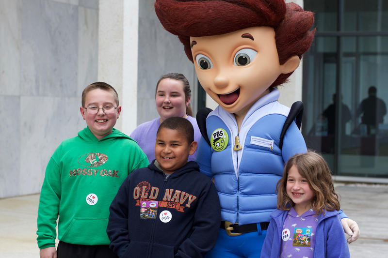 Children pose with costume character