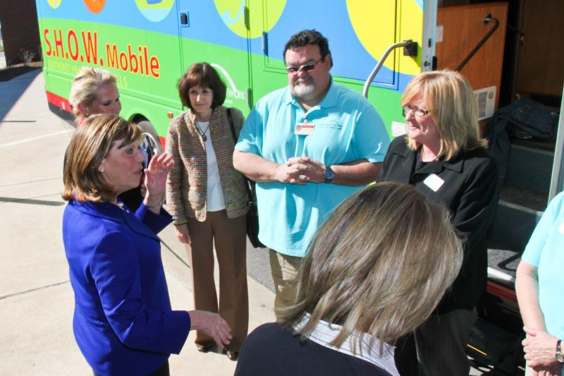US Rep Jo Ann Emmerson talks with representatives of SEMO Health Network outside of the S.H.O.W. Mobile.
