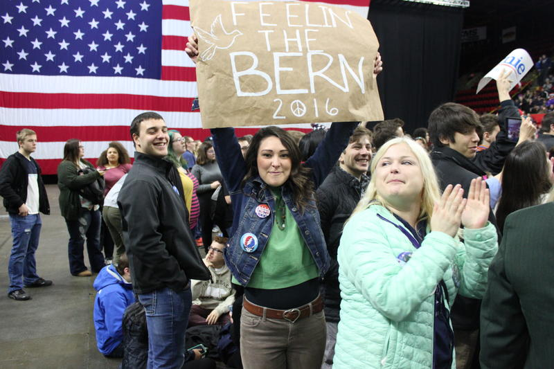 """Adelaide Dumm showing off her """"Feel the Bern"""" sign."""