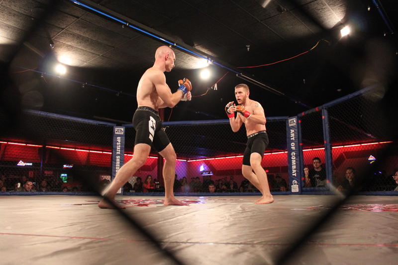 Tom Grinnell (left) and Glenn Mix got at it in the first official fight at an April MMA event at Magic City in Binghamton.
