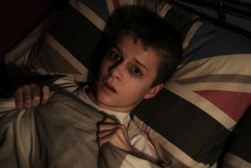 frightened boy in bed