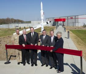 Raytheon officials and Alabama politicians cut the ribbon on the missile company's new facility in Huntsville.