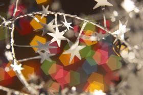 Holiday tinsel, paper and stars