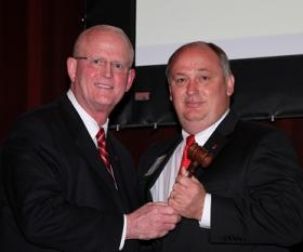 Outgoing Alabama Farmers Federation President Jerry Newby, left, passes the gavel to newly elected President Jimmy Parnell of Chilton County.