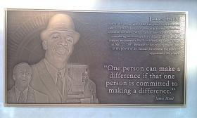 Plaque commemorating James Hood on the west face of the Autherine Lucy Clock Tower in Malone Hood Plaza on the campus of the University of Alabama in Tuscaloosa, Alabama.