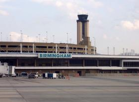 Birmingham's airport is still using a large panel of video monitors similar to one that tipped over and killed a 10-year-old Kansas boy last week.