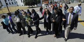 The Selma to Montgomery march re-enactors arrive at the state capitol building in Montgomery on Friday.