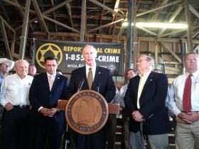 Gov. Robert Bentley joined officials with the Agriculture Rural Crime Unit Thursday at a cattle farm near Montgomery to laud the efforts of the unit.