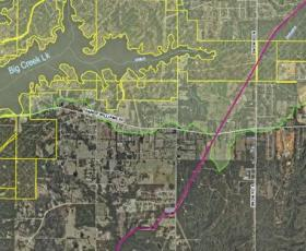 The red line represents the pipeline with Big Creek Lake outlined in yellow. The easternmost finger of Big Creek Lake, is about 3000 feet away from the proposed pipeline.