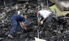 Investigators sift through the wreckage of a UPS cargo jet that crashed just outside of Birmingham-Shuttlesworth International Airport on Wednesday.