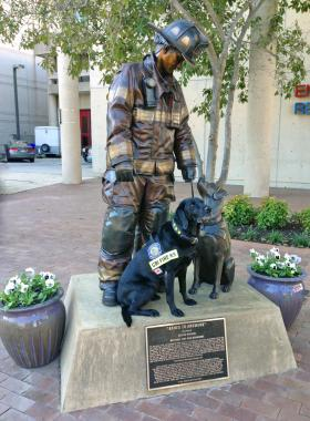 Sadie with her likeness at the National Fire Dog Monument