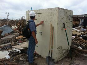 Dr. Andrew Graettinger, a University of Alabama researcher, examines a safe room that survived the tornado that struck Moore, Oklahoma, in May 2013.