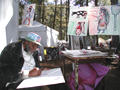 Artist John Henry Toney creates a new peice of work during the 2003 Kentuck Festival of the Arts