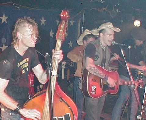 Hank III performs in Birmingham, Alabama.  Also pictured is bassist Joe Buck.