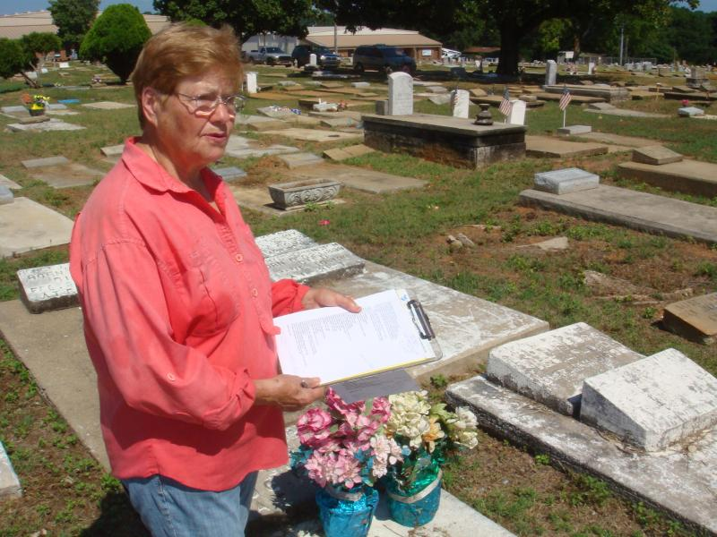 Volunteer Phyllis Armstrong compiles a list of graves that need identification.