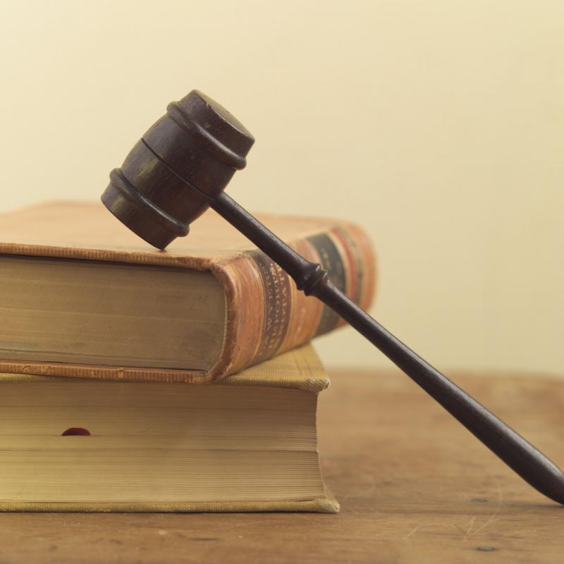 photo of gavel on stack of books