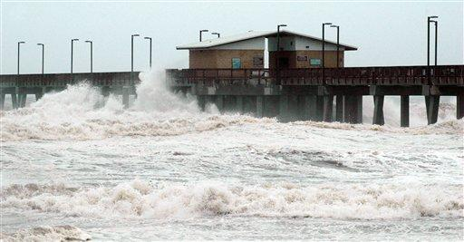 Waves crash into the public fishing pier at Gulf State Park in Gulf Shores, Ala., shortly before Hurricane Isaac made landfall in Louisiana on Tuesday, Aug. 28, 2012. Crews removed flooring panels from the pier to prevent damage.