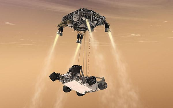 "Artists' rendering of NASA's Mars rover ""Curiosity"" being lowered to the surface by its ""skycrane"""