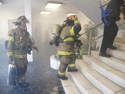 Firefighters enter Wallace Hall in August 2011 as part of a disaster preparedness drill.