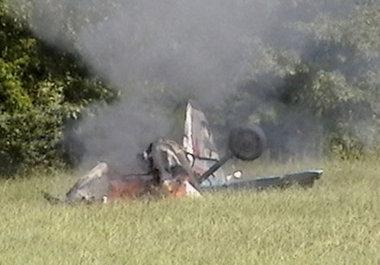 An airplane burns in a field after crashing during Moontown Fly-In activities around 3:20 PM off Morring Lane near Moontown Airport Sunday, Sept. 16, 2012 killing two. (Photo special by Samantha Williams)