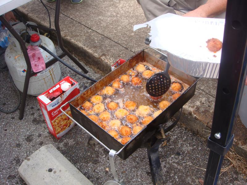 Fried candy corn dropped into a deep fryer.