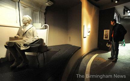 A visitor looks at an exibit honoring Rosa Parks at the Birmingham Civil Rights Institute.