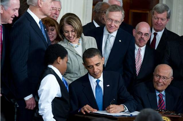President Obama signs the Affordable Care Act into law in 2010.