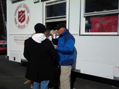 Weather Channel meteorologist Jim Cantore is seen drinking a hot beverage from the Salvation Army of Coastal Alabama's mobile canteen in midtown Mobile on Dec. 26, 2012. Cantore was covering the tornado damage that occurred on Christmas Day.