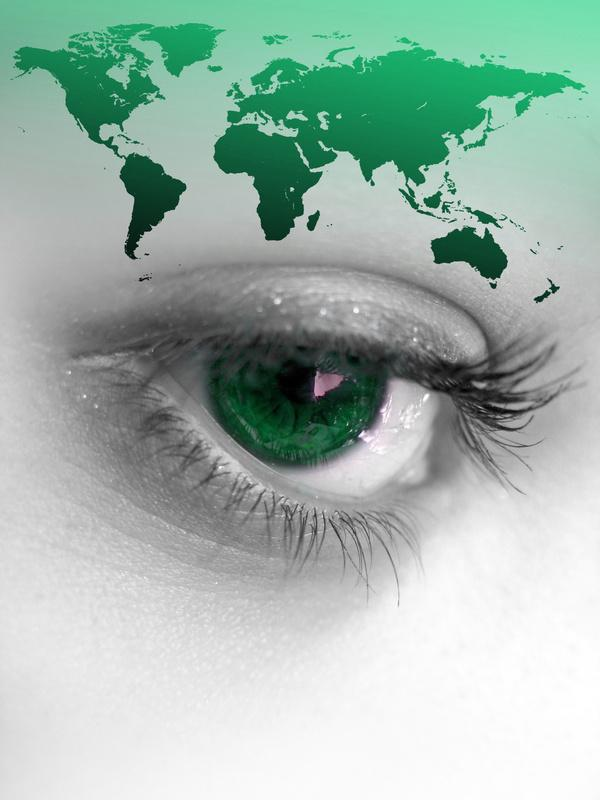 global map superimposed over closeup of female eye