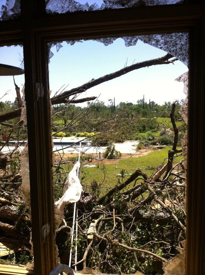 The view through the blown out windows of Steve Miller's home in the Tuscaloosa neighborhood of Hillcrest