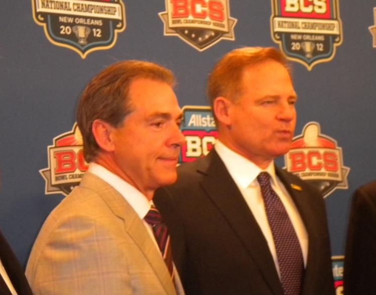 Alabama Head Coach Nick Saban with Coach Les Miles of LSU prior to the kickoff of the BCS College Football Championship in New Orleans in 2012